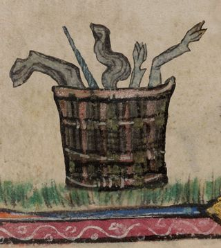 A marginal illustration of the remains of a unicorn in a basket, from a medieval manuscript.