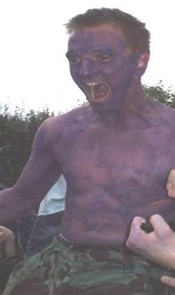 Young man painted purple at Reading Festival