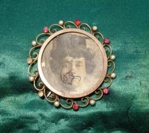 Brooch owned by Mary Leigh, enclosing photographic portrait of Emily Wilding Davison