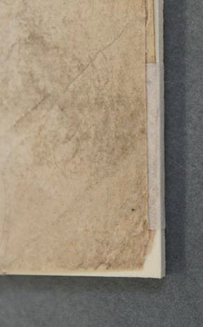 A close-up of one of the posters showing a hinge of Japanese Tissue Paper on the bottom corner, to attach the poster to Mountboard.