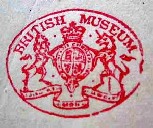 Type 2 oval stamp. The Stamp is ovoid and is coloured red, with 'British Museum' under the top edge. The heraldry of the Lion and Unicorn supporting the coat of arms with a crown atop. They in turn are supported by a flowing scroll with unreadable writing.