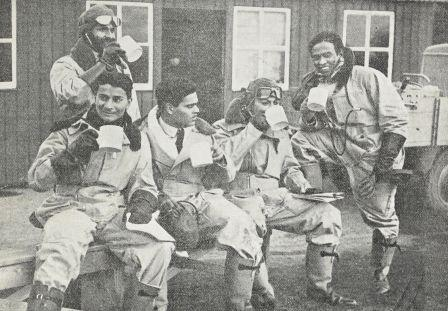 Indian pilots drinking from large mugs