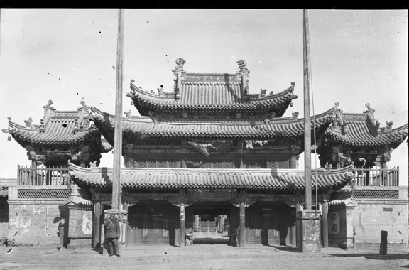 Black and white photograph of the entrance with triple tiered roof.
