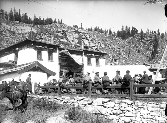 Black and white photograph of People gathering atreligious ritual in Manzushir monastery
