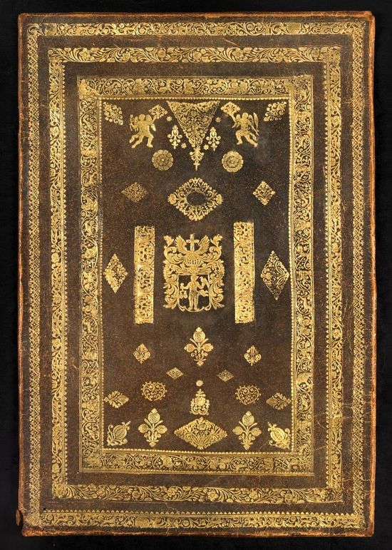 This volume has a dark brown leather with a myriad of gold tooling on the cover. Three rectangular designs are done around the cover's edges, with a variety of floral, geometric, and other designs in the centre of these rectangular designs.