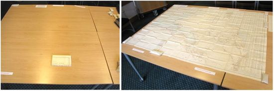 Two images side-by-side. Left: a small folded item rests on a table. In its folded state, it looks comically small compared to the table. Right: The item has been unfolded on the table, held open with weight bags around the edges, and fills nearly the entire table surface.