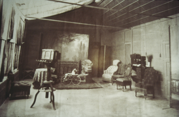Photograph of the studio with a camera in the foreground.