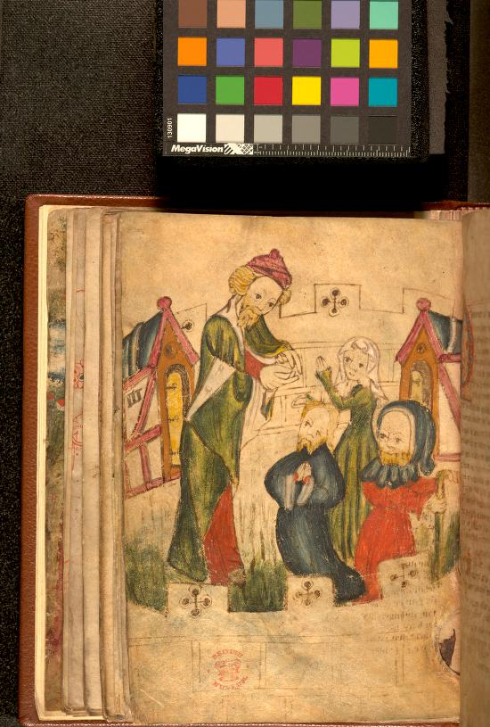 A book lies open on a black background. The left-hand page is shown and is filled with a hand-drawn picture of four medieval people in a turret with crenelated walls. Three are kneeling down, on the right side of the picture. Two of these, a man in a blue gown and a lady in a green dress and white headdress, are holding their hands together as though praying. The third kneeling figure is wearing a red tunic and blue hood. He is holding a stick and looking over his shoulder towards the left side of the page. On the left side of the picture the fourth figure, a man, is standing over the other three. He is wearing a red and green gown and a red hat or turban. Above the volume is the calibration target, which is a black piece of cardboard covered with 24 brightly-coloured squares in different colours. The squares are laid out horizontally in four rows of six. Along the bottom of the target is a measurement scale in centimetres and millimetres.