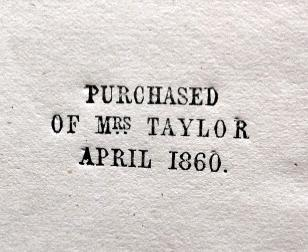 """The stamp """"Purchased of Mrs Tayor 1860"""" is stamped in black on white paper."""
