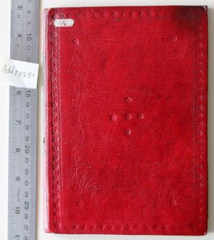 The front board of a book bound in red leather. It is decorated with a border of lines and small five-petalled flowers. There are also five-petalled flowers arranged in a cross in the middle of the board, and one five-petalled flower in each corner of the border.