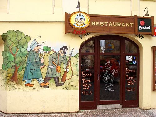 Front of the Svejk restaurant in Prague decirated with copies of Josef Lada's illustrations