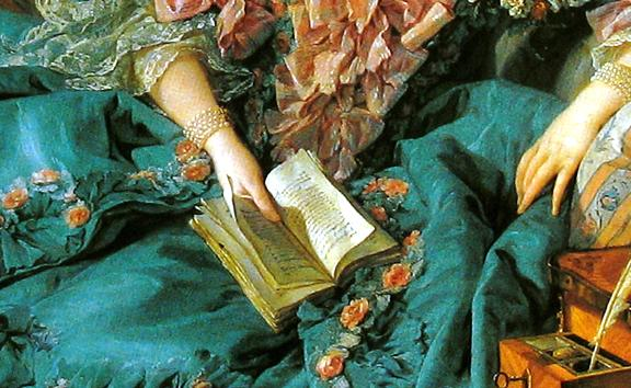 A closeup of the book in the woman's hands--the book is open.