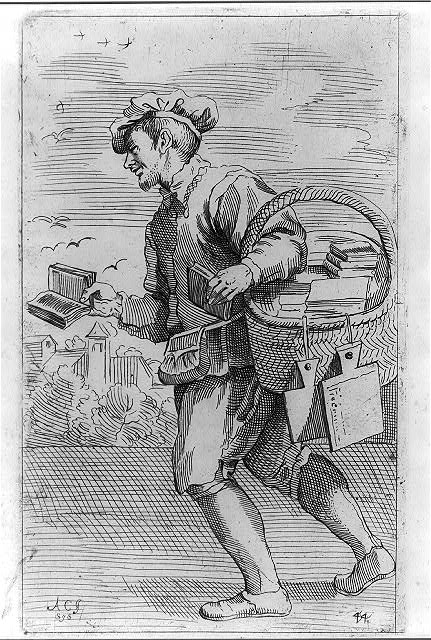 A man holds a basket of books in one hand and an open book out in the other.