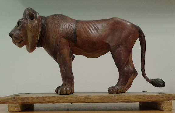 A model of a lion.   By Gangaram, 1790.  Wax, possibly dhuna, the aromatic gum of the shal tree (Shorea robusta), painted; size of wooden base: 20.5 x 9.75 x 2cm; animal 12.5cm at highest point of mane.  F872