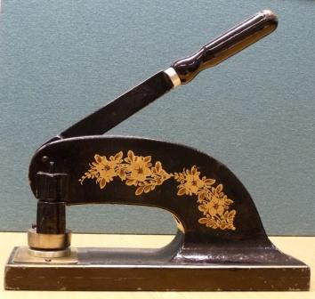 Machine which embosses the seal on certificates issued