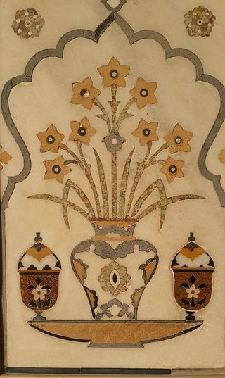 Vase of narcissi with covered cups, intarsia detail from the tomb of Itimad al-Daula, Agra, begun 1622. Photo by William Dalrymple, 2013, and reproduced with his kind permission