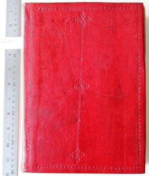 """The front board of a book bound in decorated red leather. The decoration has all been stamped (""""tooled"""") on to the book and is """"blind"""", meaning it is not coloured. The board is decorated with a border of lines and small five-petalled flowers. There is a double vertical line down the centre of the board. At the top, middle and bottom of the line it is broken up by four diamond-shaped motifs created from four shamrock-shaped stamps with a small five-petalled flower in the middle. There are single five-petalled flowers tooled on the line between the top and middle and middle and bottom diamonds."""