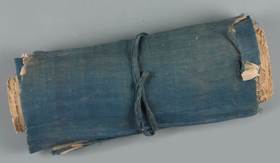 A scroll with a blue cloth cover