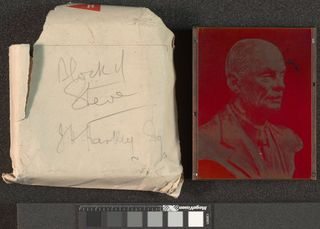 The left of the Image depicts cream envelope used to store printing block with graphite inscription. To the right of the image is the printing block of Steve Fairbairn