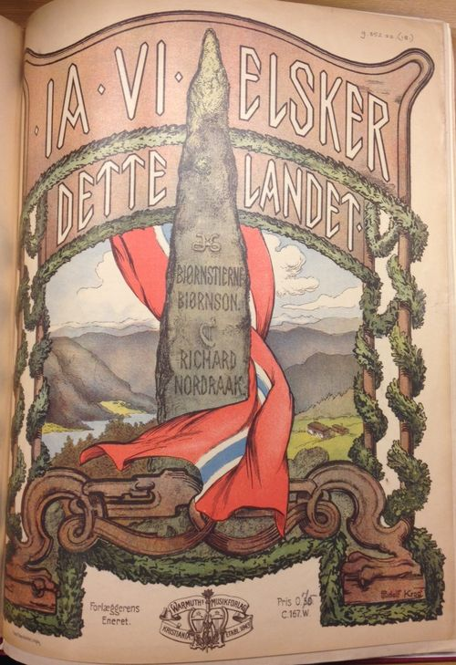 Cover of  'Ja vi elsker dette landet' with an image of a standing stone draped in a Norwegian flag againsrt a background of a fjord, mountains and rural landscape