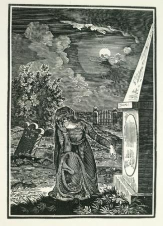 Woman kneeling in graveyard
