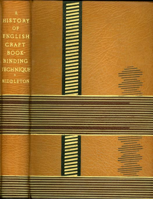 The spine and front cover bound in a mustard yellow leather, with a series of horizontal lines running across at the middle and bottom of the book. There is a vertical black line with diagonal horizontal lines running about one third of the way across the front cover.