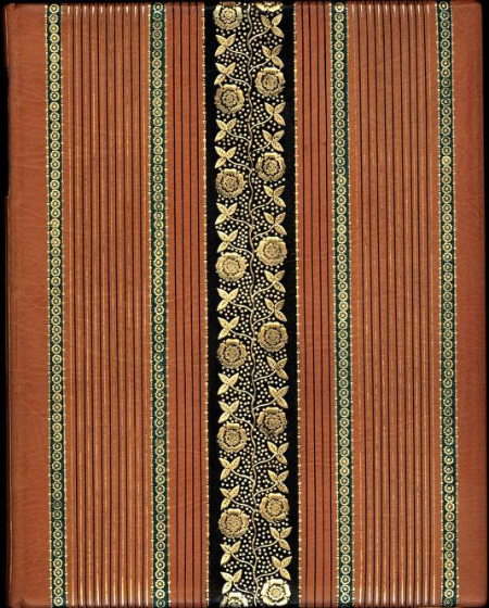 The cover in a tan-orange colour, with stripes mirroring the spine (smaller ones plus larger green ones with geometric designs). In the centre is a large black stripe with pattern in gold leaf running down it.