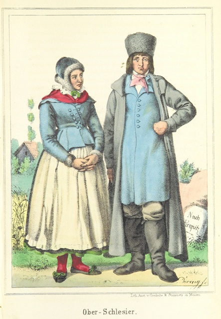 A man and woman wearing traditional Upper Silesian costumes in blue, white and red