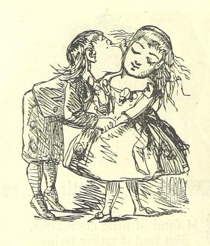 Little boy kissing a little girl on the cheek