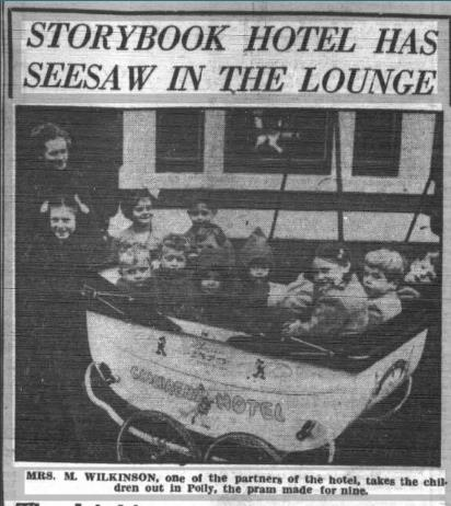 Newspaper article about Peter Rabbit Hotel - photo of several children in large pram