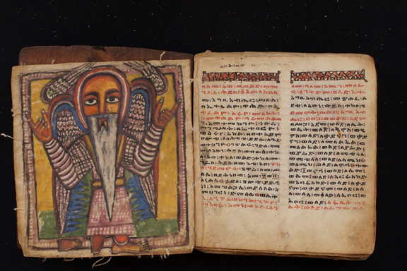 An Ethiopic manuscript, illustration of an angel on left page and text on the right