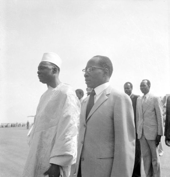 Malian President Moussa Traoré and Senegalese President Léopold Sedar Senghor stand next to each other.