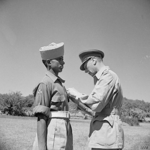 King George VI pinning the Victoria Cross on Sepoy Kamal Ram