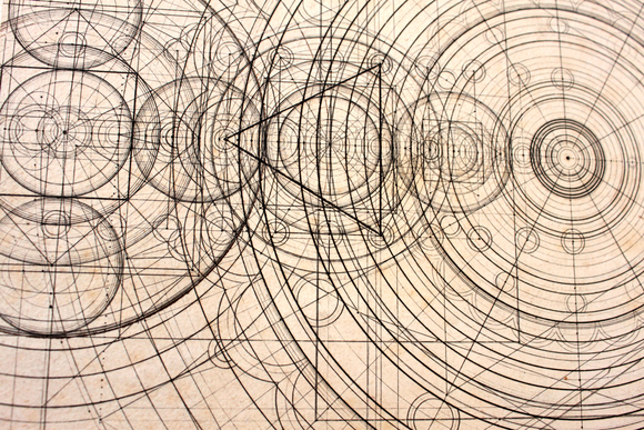 A detail of a drawing: geometric shapes, mainly circled, overlap one another and are drawn in a dark ink.