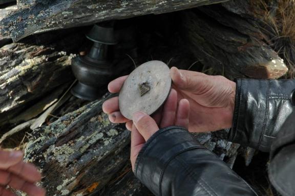 Items found including a small votive stupa.