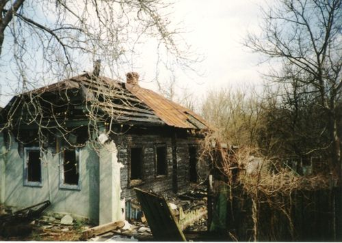 Abandoned and ruined house near Chornobyl