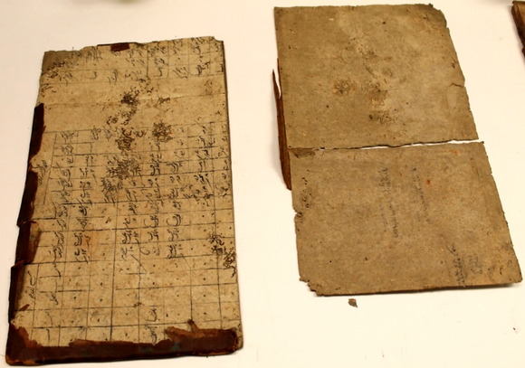 An image of both book boards--the left board has columns of text.