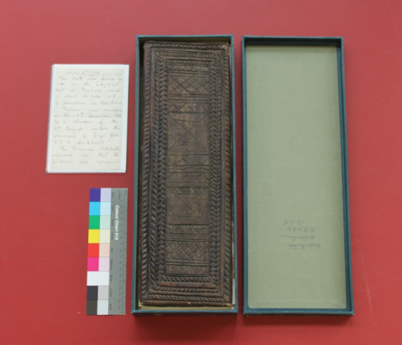 A birds-eye view showing the conserved item back in its box.
