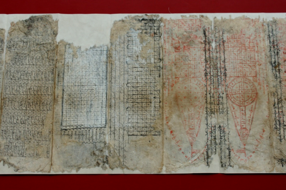 Another section of the manuscript following repair.