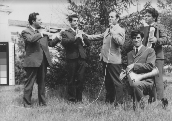 Photograph of a group of musicians playing their instruments.