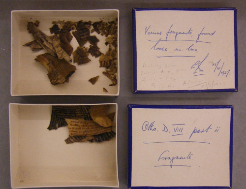 Boxes of manuscript fragments, damaged by the Cotton Fire.
