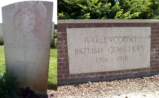 On the left is the white gravestone with a cross engraved at the bottom, and on the right is an image of the sign for Warlencourt British Cemetery in white stone on a brick wall.