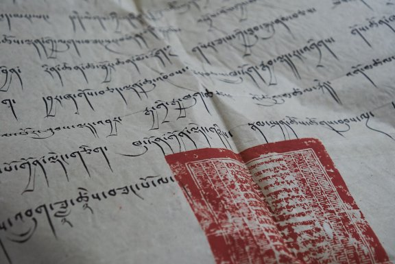 Close up of Tibetan writing with seal.