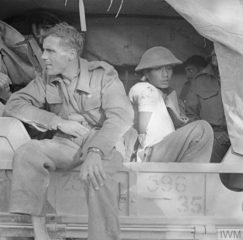 © IWM NA 9418 Wounded soldiers from 8th Indian Division being transported in the back of a lorry, 28 November 1943