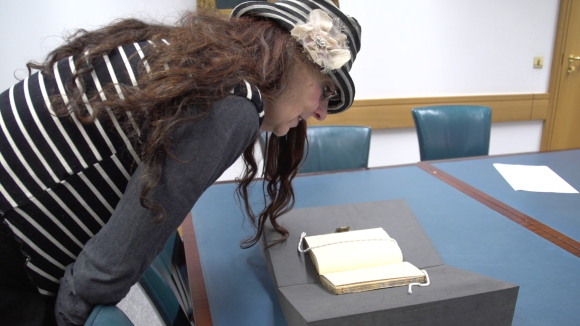 Penny Dimond looking at Henry Nicholett's diary