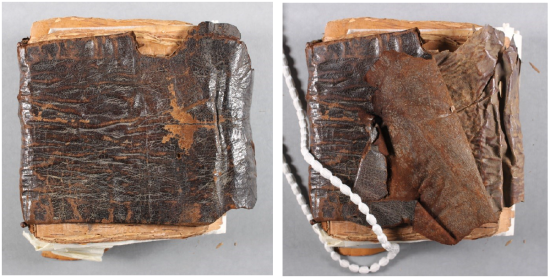 Two images of the manuscript showing a dark brown leather cover, wrapped around the manuscript, which is not covering the top and bottom of the text leaves. The right hand image shows the cover slightly eased back, revealing the underside of the leather as a lighter brown, with a white snake weight holding it back at the bottom left.