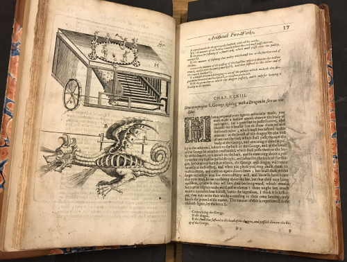 Double opening, one page text, one with illustration of a mechanical dragon
