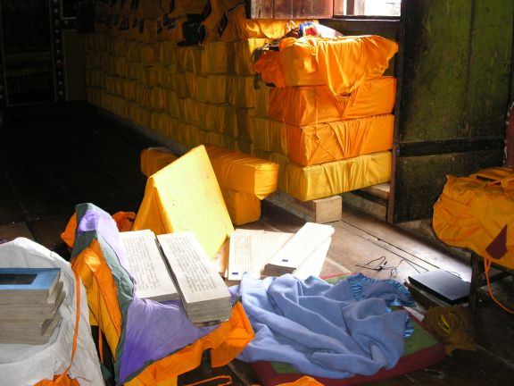 Manuscripts wrapped up in saffron coloured cloth.