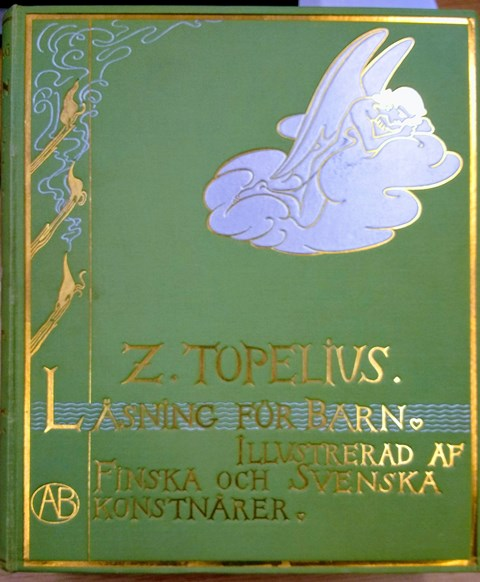 Cover of 'Läsning för barn', a green background with gold lettering and a design of torches, a river and a cloud
