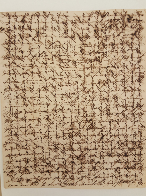 Cross-hatched letter, with writing continued at 90 degress across the page, which produces a lattice effect